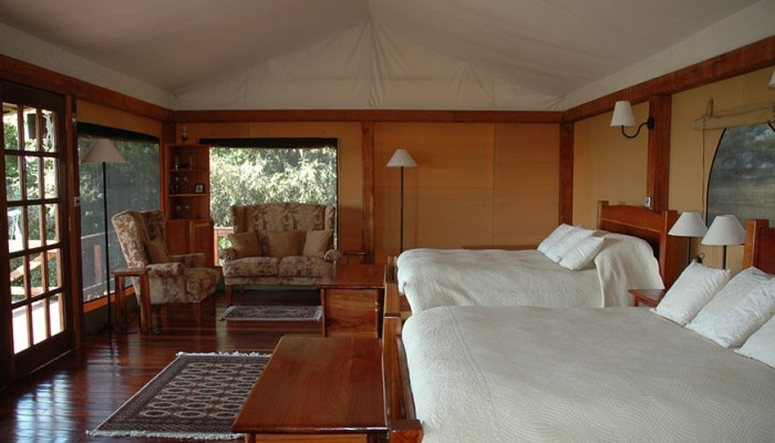 Unique cedar furniture of a chalet at Mara West Safari Camp.