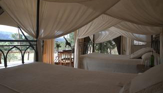 The tent interior at Nkorombo Selous Camp.