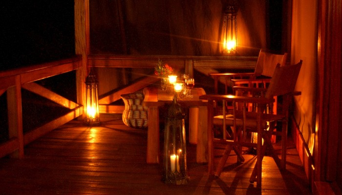 Evening winding down at a chalet deck in Mara West Safari Camp.