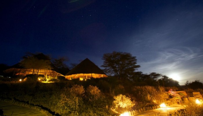 Night view of Tortilis Safari Camp.